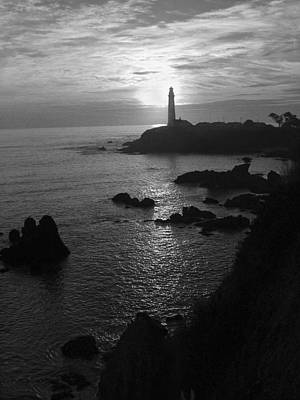 The Sun Is Setting Behind The Pigeon Point Light Station Near Ano Nuevo Poster