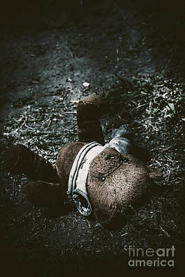 Toy Teddy Bear Lying Abandoned In A Dark Forest Poster