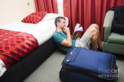 Travelling Man Holding Travel Itinerary Poster by Jorgo Photography - Wall Art Gallery