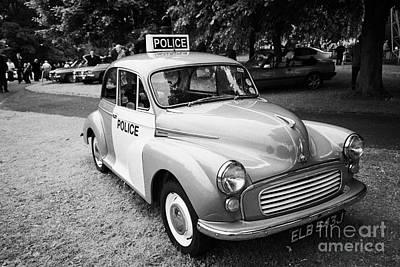 Vintage Morris Minor Police Car At A Car Rally County Down Northern Ireland Uk Poster by Joe Fox