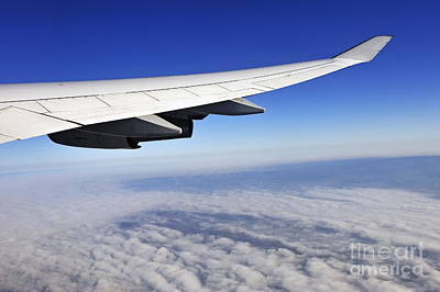 Wing Of Flying Airplane Above Clouds Poster by Sami Sarkis
