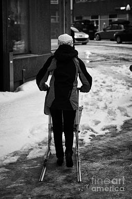 woman pushing kick sled out shopping on ice covered storgata main shopping street Honningsvag finnma Poster by Joe Fox