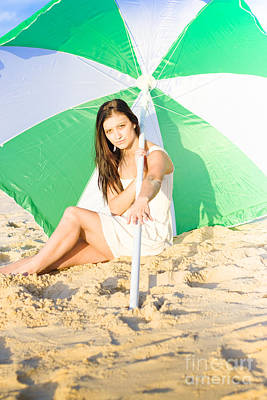 Woman Sitting On Beach With Umbrella Or Parasol  Poster by Jorgo Photography - Wall Art Gallery