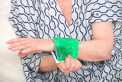 Woman With A Cold Compress On Wrist Poster by Lea Paterson