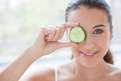 Woman With Slice Of Cucumber Poster