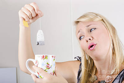 Worker With Look Of Relief Holding Tea Bag And Cup Poster
