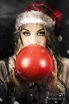 Young Christmas Girl Blowing Up Party Balloon Poster