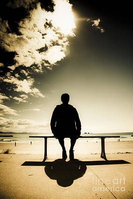 Young Man In Silhouette Sitting In The Sun Poster