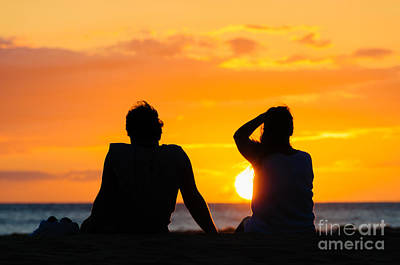 Couple Watching The Sunset On A Beach In Maui Hawaii Usa Poster