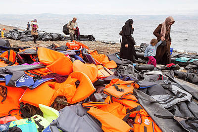 Syrian Refugees Arriving On Greek Island Poster by Ashley Cooper