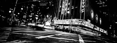 Low Angle View Of Buildings Lit Poster by Panoramic Images
