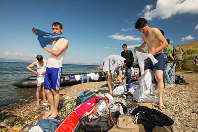 Syrian Refugees Arriving On Greek Island Poster