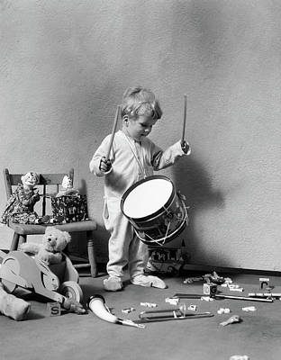 1930s Boy In Pajamas Beating On Toy Poster