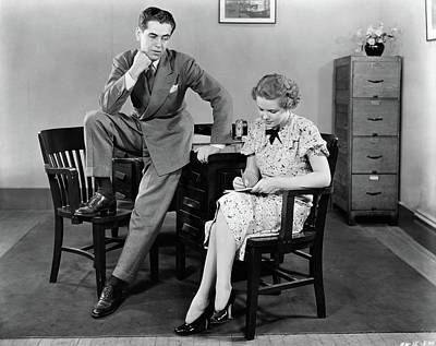 1940s Businessman Leaning Against Desk Poster