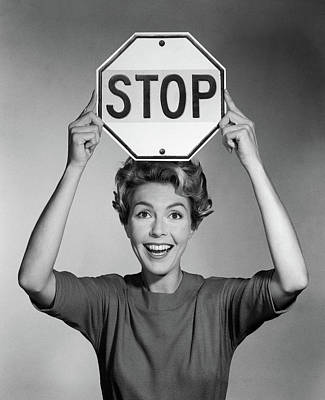 1950s 1960s Smiling Woman Holding Stop Poster