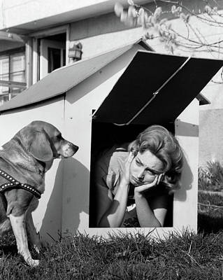 1950s 1960s Woman In Doghouse With Dog Poster