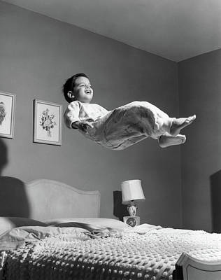 1950s Boy In Pajamas Elevated Above Bed Poster