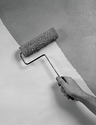 1950s Hand Using Paint Roller On Wall Poster