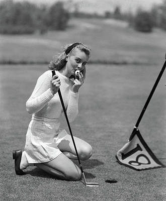 1950s Woman Golfer Kneeling By Cup Poster