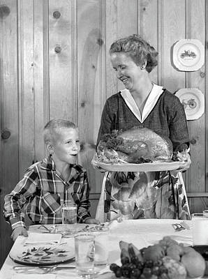 1950s Woman In Apron Putting Turkey Poster