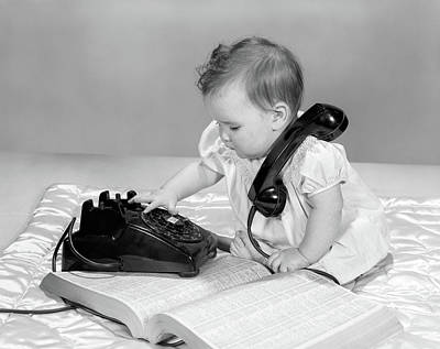 1960s Baby Girl With Telephone Book Poster
