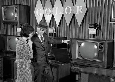 1960s Couple Shopping For Color Tvs Poster