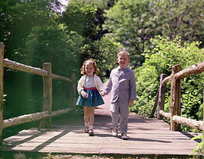 1960s Little Boy And Girl Holding Hands Poster