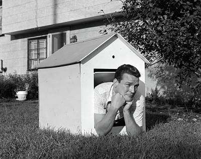 1960s Man In Doghouse In Backyard Poster