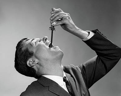 1960s Man In Suit And Tie Swallowing Poster