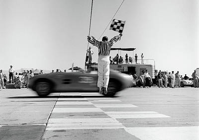 1960s Man Jumping Waving Checkered Flag Poster