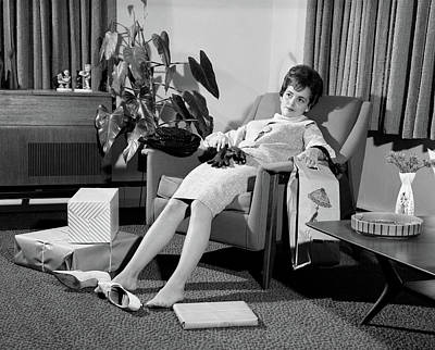 1960s Woman Plopped Down In Armchair Poster