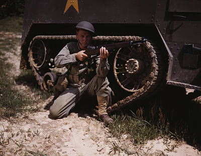 A Soldier Holds And Sights His Garand Poster by Stocktrek Images