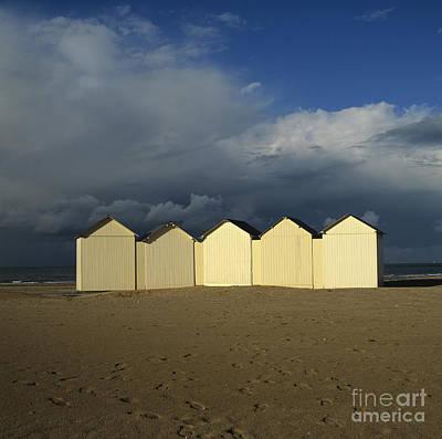 Beach Huts Under A Stormy Sky In Normandy. France. Europe Poster by Bernard Jaubert