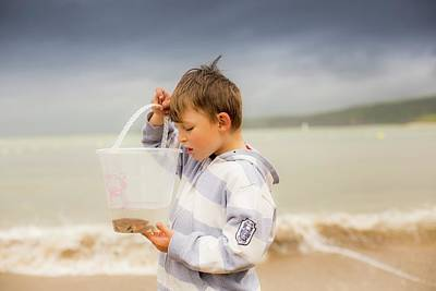 Boy Holding Crab Poster