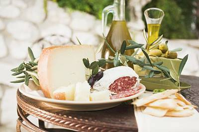 Cheese, Salami, Olives, Olive Oil, Crackers On Outdoor Table Poster