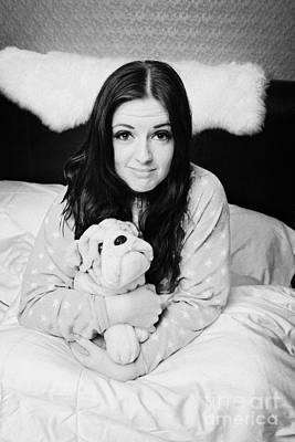 Early Twenties Woman Holding Cuddly Dog Soft Toy In Bed In A Bedroom Poster