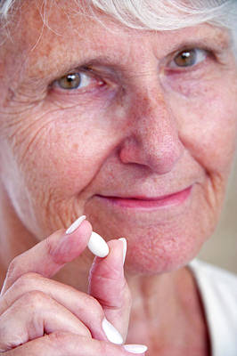 Elderly Woman With Medication Poster