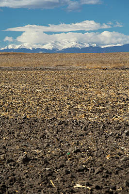 Farmland Below The Rocky Mountains Poster by Jim West