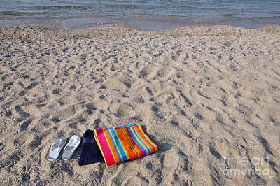 Flip Flops And Towels On Beach Poster