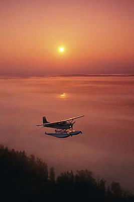 Floatplane Flying  Sunset Matanuska Poster by Jeff Schultz