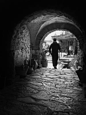 Poster featuring the photograph Man In An Archway / Hammamet by Barry O Carroll