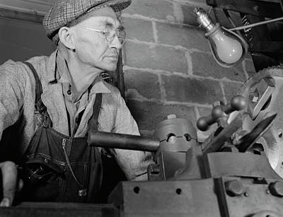 Man Working In A Small Machine Shop Poster