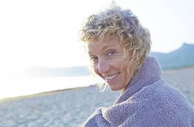 Mature Woman On Beach Poster by Ruth Jenkinson