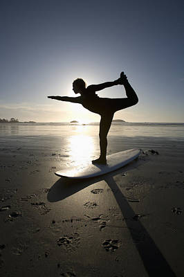 Silhouette Of Female Surfer Doing Bow Poster by Deddeda