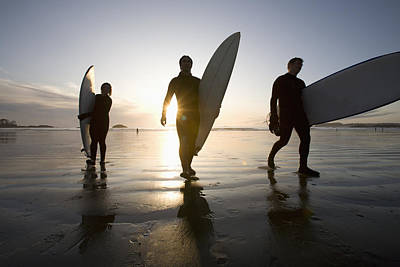 Silhouette Of Three Surfers Carrying Poster by Deddeda