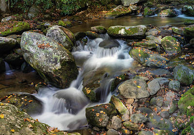 Stream Flowing Through Rocks Poster