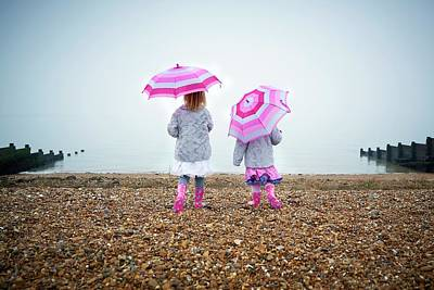 Two Girls On Beach Holding Umbrellas Poster by Ruth Jenkinson