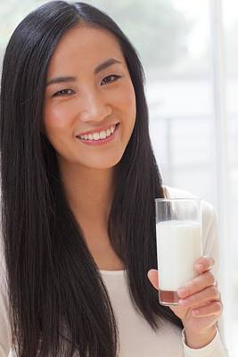 Woman Holding Glass Of Milk Poster by Ian Hooton