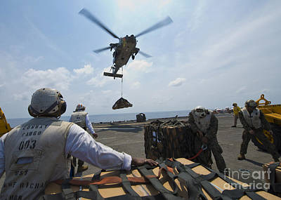 An Mh-60s Sea Hawk Helicopter Lowers Poster
