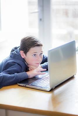 Boy Using A Laptop Poster by Samuel Ashfield